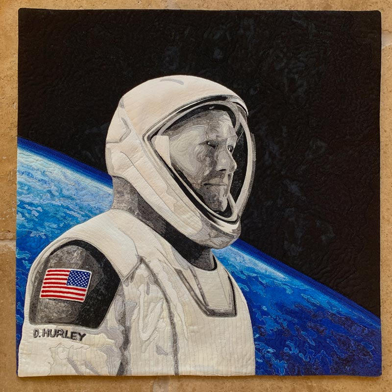 Textile artwork of Astronaut Doug Hurley, who made history as being one of two astronauts to blast off into space from U.S. soil since 2011.  Doug Hurley was the spacecraft commander of the SpaceX Dragon Endeavor mission that launched on May 30, 2020.